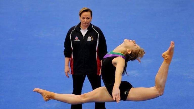 Lauren Mitchell trains under the watchful eye of coach Peggy Liddick.