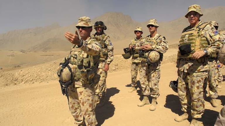 Lieutenant Colonel Stuart Yeaman (front) with colleagues in former Taliban territory, Oruzgan Province, Afghanistan.