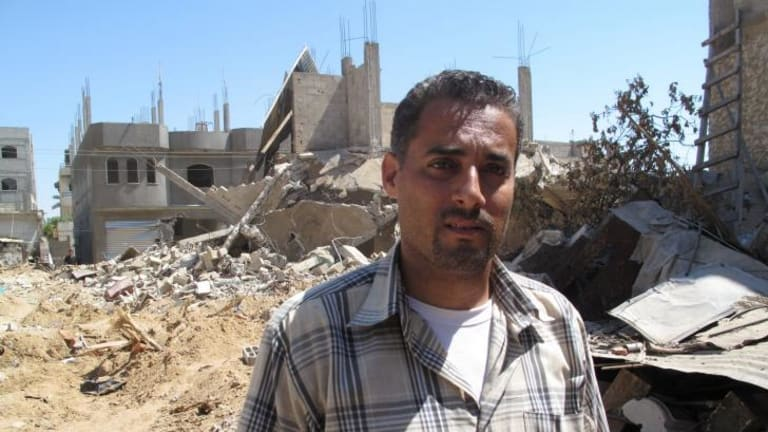 At least 14 members of Tamer Abu Rujalia's family were killed in the fighting over the past month.