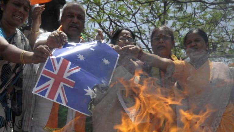 Activists of India's main opposition Hindu-nationalist Bharatiya Janata Party  burn Australia's national flag during a protest in  Hyderabad at the weekend.