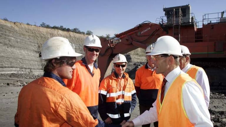 Tony Abbott with workers at Bloomfield mine.