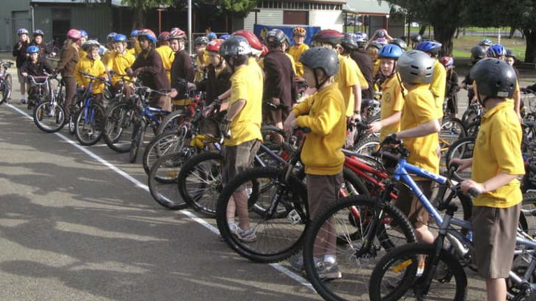 Skills base: children receiving cycling tuition at school in Victoria.