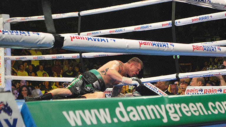 Danny Green is dealt the knockout blow from Krzysztof Wlodarczyk. <i>Photo: Geoff Smith.</i>