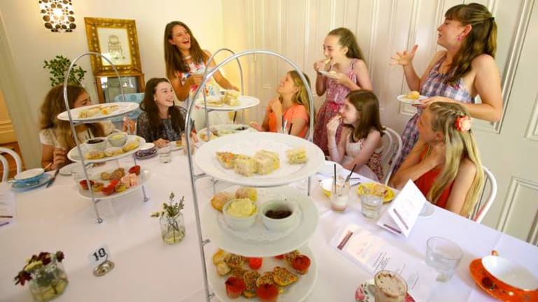 So very mature: A party of girls playing grown ups as they enjoy their hot chocolate and pink lemonade high tea at the Boronia Tea Room in Mosman.