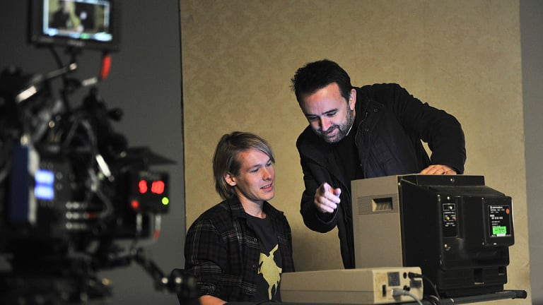 Alex Williams, who plays Julian Assange, with Connolly on the set of <i>Underground</i>.