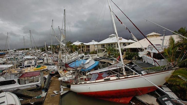 Boats lay strewn around Port Hinchinbrook in the wake of Cyclone Yasi.