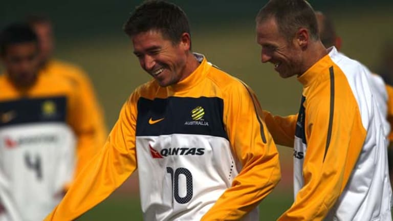 Smiling assassin? ... Harry Kewell shares a laugh with defender Craig Moore at training this week. A fit again Kewell will be crucial to Australia?s chances of defeating Ghana.