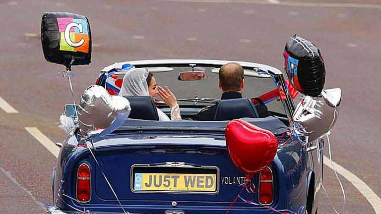 The royal couple leave Buckingham Palace for Clarence House.