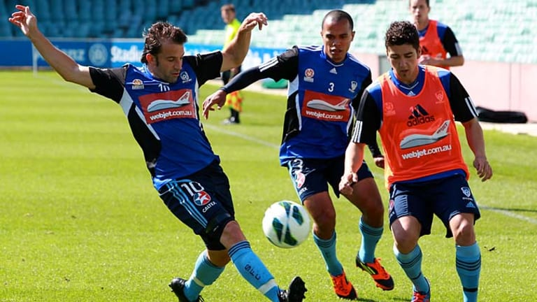 Full stretch ... Alessandro Del Piero moves in to challenge Dimitri Petratos yesterday.