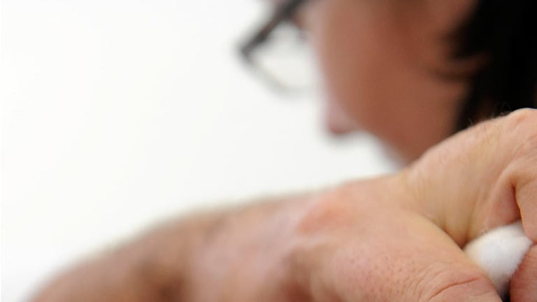 The whooping cough adult vaccination scheme was established by the Bligh government in 2009.