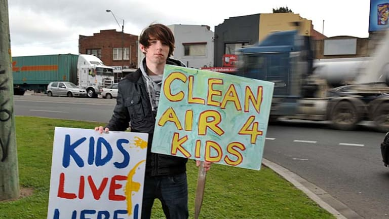 Noah Lautman-Wurt, on the corner Williamstown Road and Francis Street, protesting truck noise.