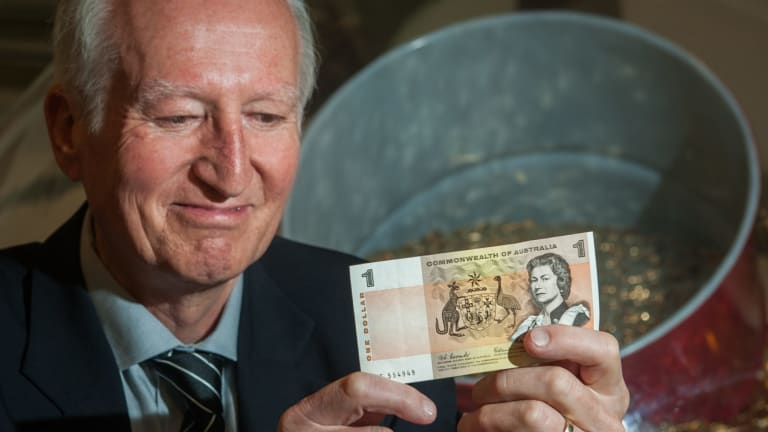 Canberra author Peter Rees at the Royal Australian Mint with a $1 note he received in his first pay packet in the same week Australia converted to decimal currency.