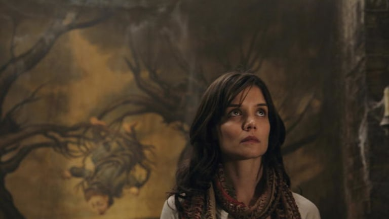 Fright night ... things are going bump in the night for Kim (Katie Holmes).