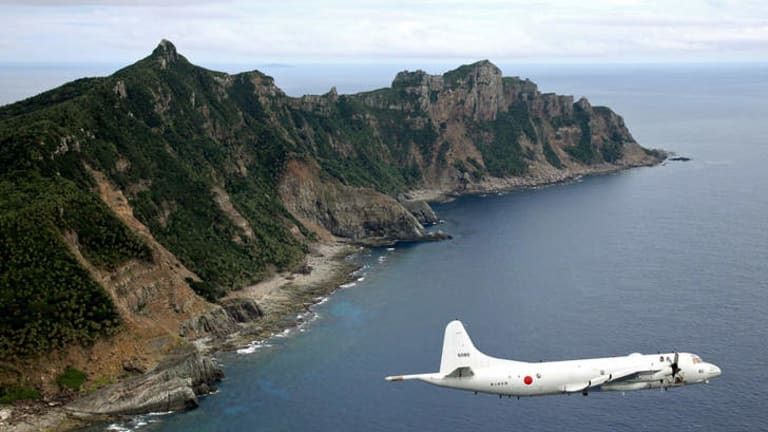 Disputed territory: Japan Maritime Self-Defence Force's P-3C Orion surveillance plane flies over the disputed islands, called the Senkaku in Japan and Diaoyu in China, in 2011.