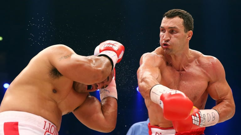 Too strong: Klitschko made short work of the challenger, beating Leapai in five rounds.