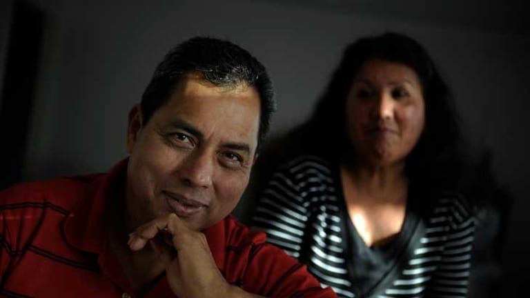 Victor Barrientos, with his wife Ana, is paid $21 an hour and works 11-hour days, six days a week.