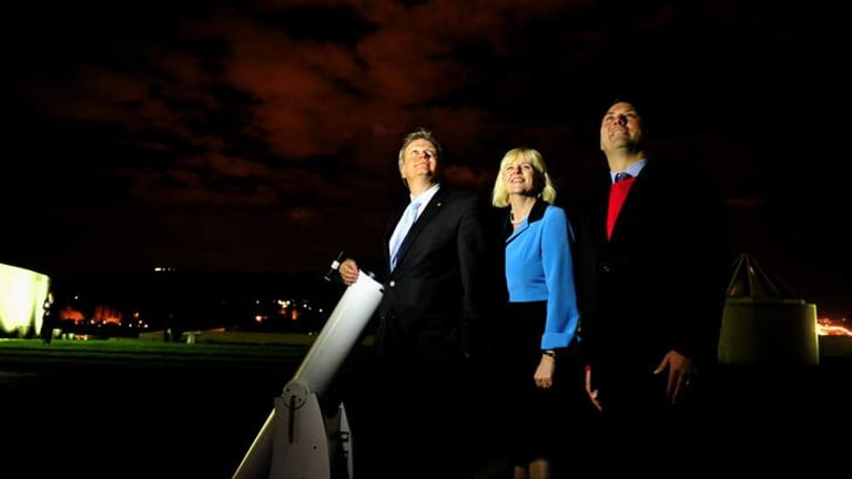 Professor Brian Schmidt on the roof of Parliament House with MPs Karen Andrews and Richard Marles last night at an event hosted by the Parliamentary Friends of Science.