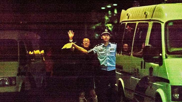 Flashback to August ... Matthew Ng waving to his wife Niki outside a courthouse in China.