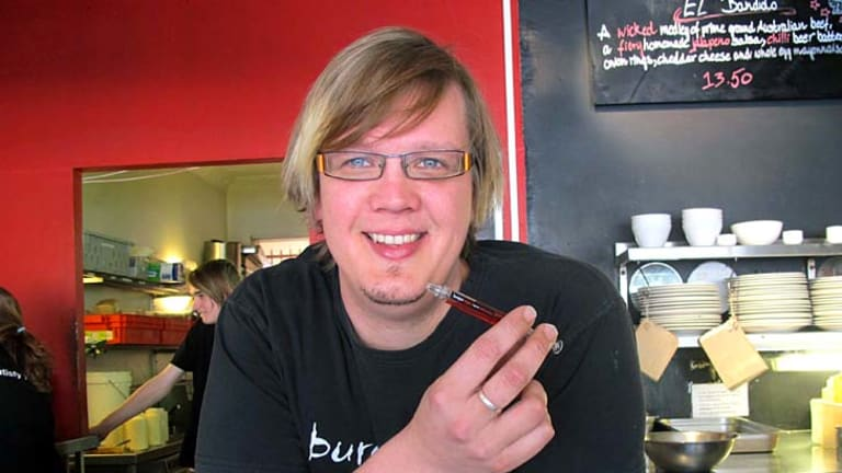 Burger Urge Fortitude Valley co-owner Colby Carthew with the controversial syringe-like pen.
