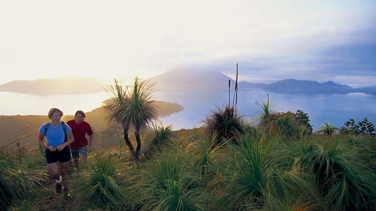 Hikers take the high trail on Lindeman Island.