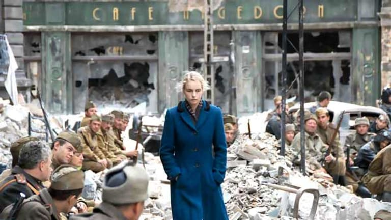 Actress Nina Hoss walks past a group of leering Soviet soldiers in the film A Woman in Berlin.