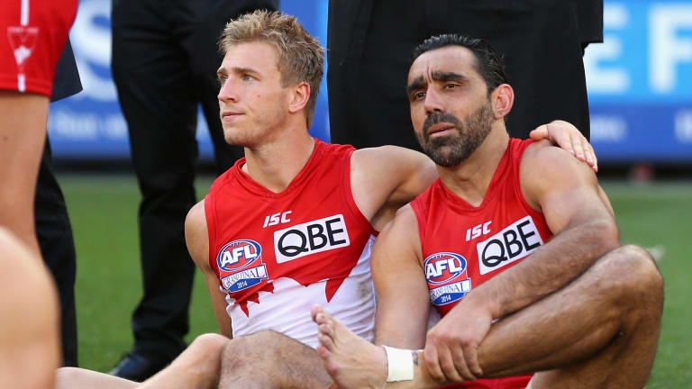 A long way to go: Adam Goodes (right) was racially abused during the grand final.
