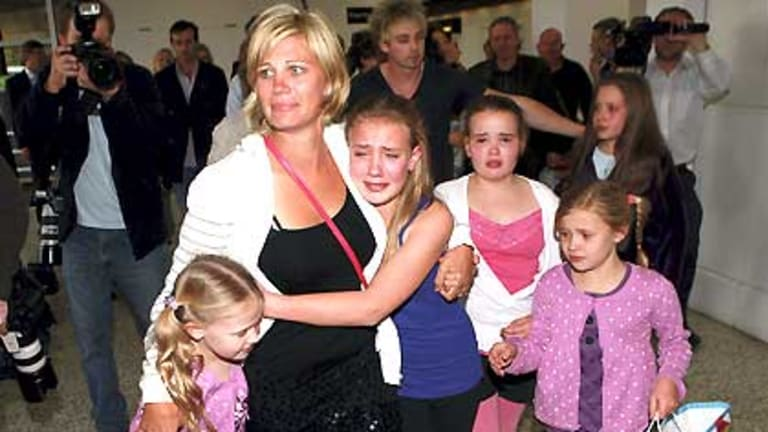 Annice Smoel is reunited with her daughters at Melbourne Airport.