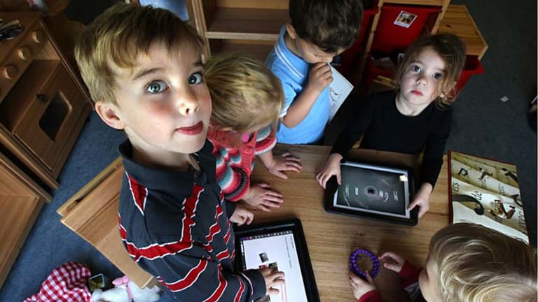 Stimulating creativity: KU Killara Park preschoolers use educational apps on the school's iPads.