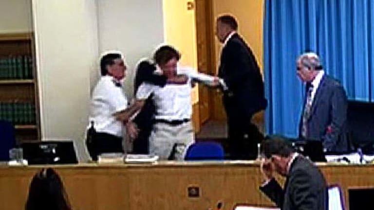 David Lawley-Walkin is tackled by security.