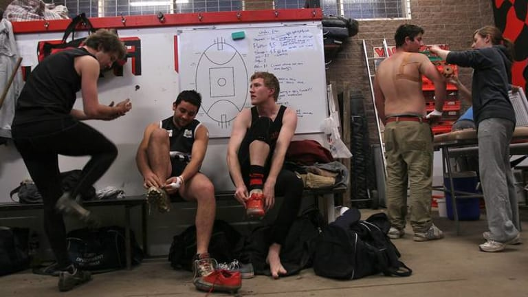 Out and proud: Yarra Valley footballer Jason Ball, third from left, wants the AFL to air anti-homophobia videos at the grand final this month.