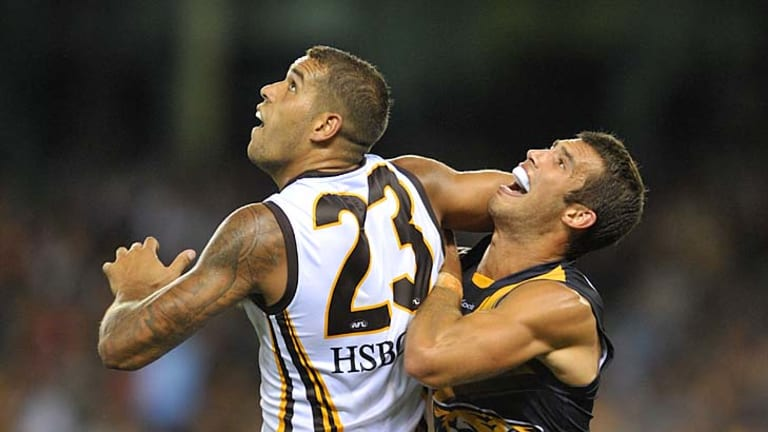Eyes up: Lance Franklin (left) and Alex Rance go for the ball.