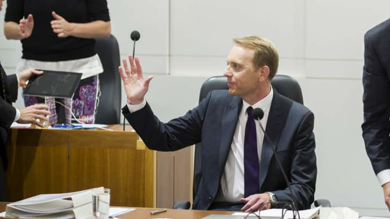 Simon Corbell acknowledges a standing ovation from the public gallery after introducing the Marriage Equality Bill in the ACT Legislative of Assembly in September.
