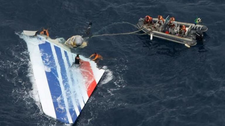 Sailors pick a piece of debris from Air France flight AF447 out of the Atlantic Ocean in 2009. It took two years to find the plane's black box.