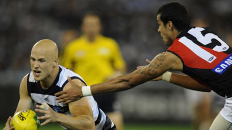 Gary Ablett escapes the clutches of Essendon's Courtenay Dempsey.