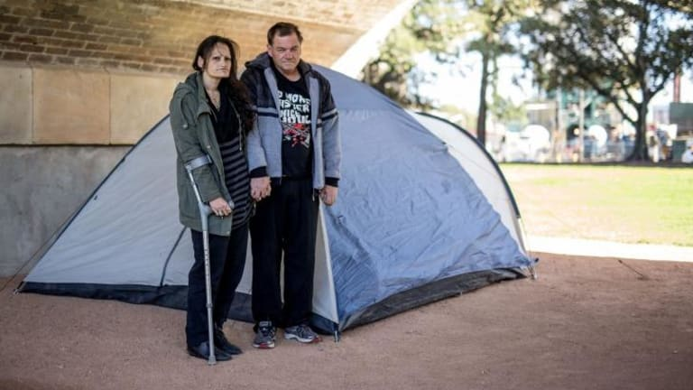 Lara and Matthew live in their tent under the arches.