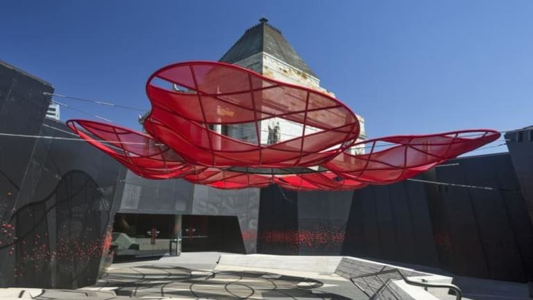 Stark: A large shade canopy in the form of a red poppy floats overhead in one of the new courtyards at Melbourne's Shrine of Remembrance, redeveloped by ARM Architecture.