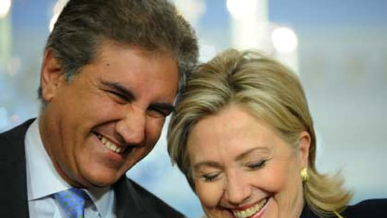 """Today, I am a happy and satisfied man""...Pakistan's Foreign Minister, Shah Mehmood Qureshi, with the US secretary of state, Hillary Clinton, in Washington."