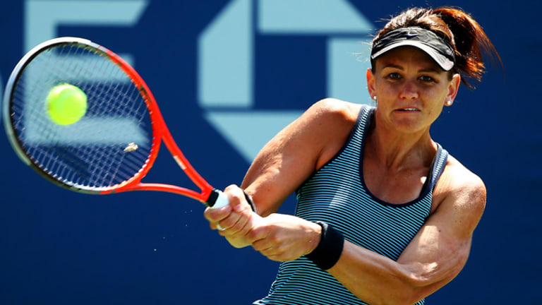 Casey Dellacqua returns a shot during her women's singles first round match against Ajla Tomljanovic of Croatia at the US Open.