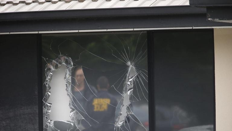 Broken windows at a house in Hallam after Saturday's terror raids.