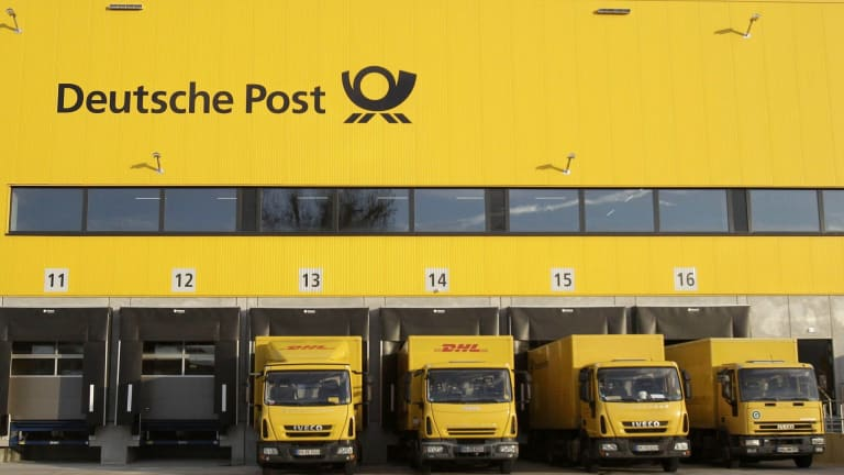 Trucks parked at Deutsche Post DHL in Berlin. The company is planning on using yellow buses.