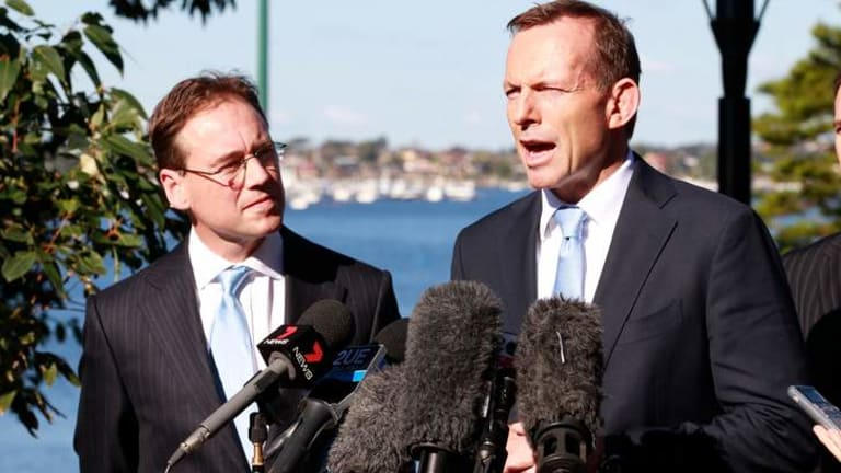 Opposition leader Tony Abbott in Sydney earlier this month with Coalition environment spokesman Greg Hunt. The Coalition has attacked the government's move to an emissions trading scheme earlier than planned.