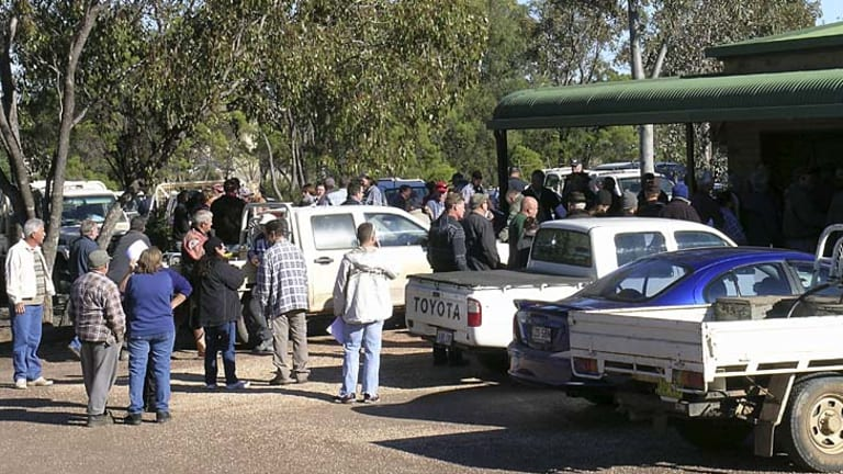 In for a share ... a crowd gathers in Lightning Ridge to apply for prospecting rights following the discovery of opal on a nearby grazing property.