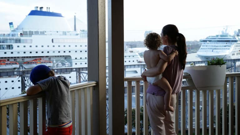 Worrying: Balmain resident Belinda Fitzgerald with 18 month old Lennox and Hewson, 5, watch the Pacific Pearl at White Bay Cruise Terminal.