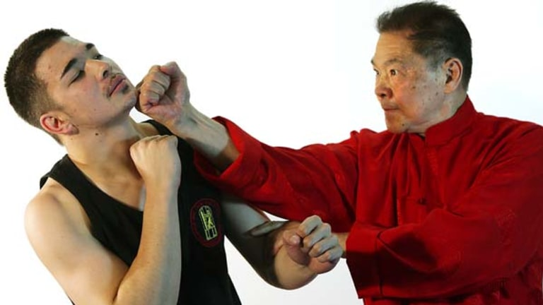 Grand master of Wing Chun Kung Fu, William Cheung, 70, spars with his son Andrew, 19.