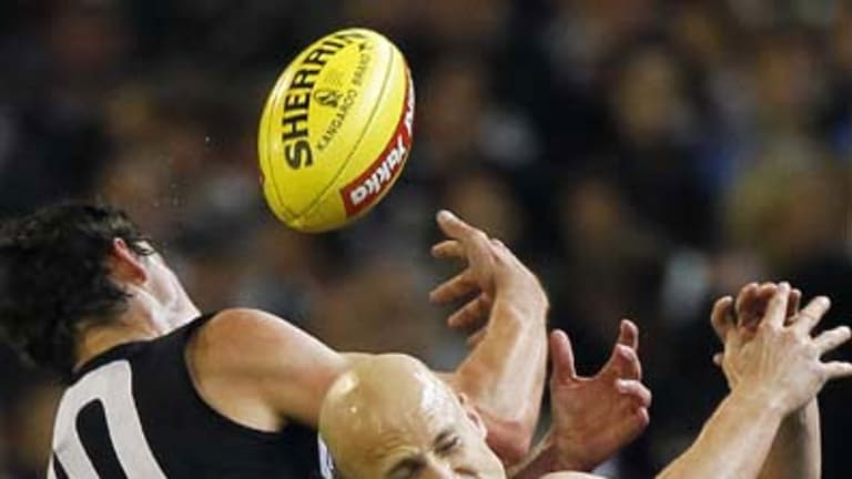 Collingwood's Scott Pendlebury and Geelong's Gary Ablett contest a mark in last night's big clash at the MCG.