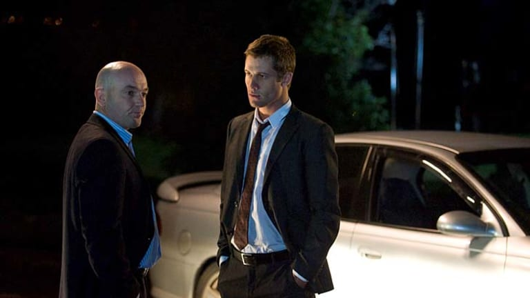 Paul Ireland (left) and Scott McGregor from <I<Neighbours</I> go real-time in tonight's episode.