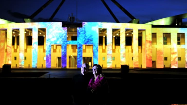 Kerry Johns and her husband John McIntyre enjoy the Enlighten Festival in March.