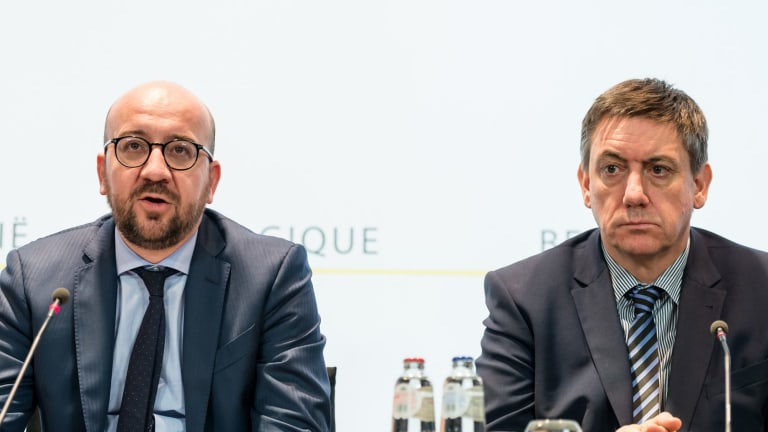 Belgian Prime Minister Charles Michel, left, and Belgium's Interior Minister Jan Jambon address the media in the wake of the attacks.