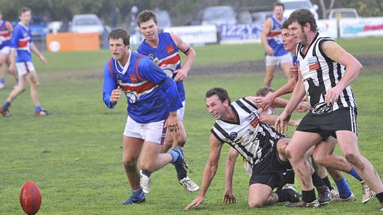 Finale: Hamilton Imperials and Hamilton players on the run in what is expected to be the last local derby between the clubs, on July 1.