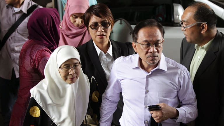 Malaysia's opposition leader Anwar Ibrahim, second right, arrives with his wife Wan Azizah, for the verdict in his final appeal against a conviction for sodomy, at the federal court in Putrajaya in 2015.